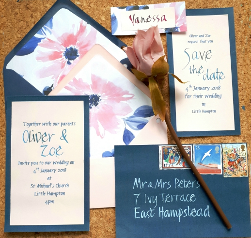 Pink and navy themed stationery suite