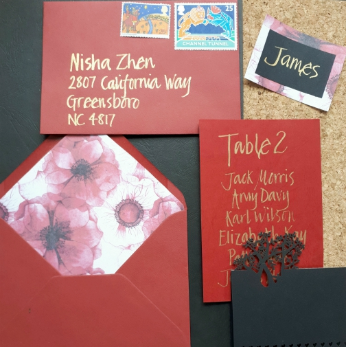Red and black themed stationery suite