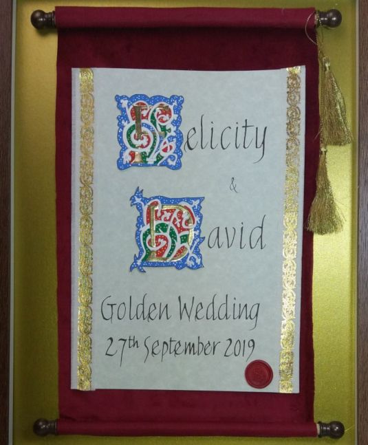 Large box framed scroll in 'White Vine' design, with handwritten calligraphy